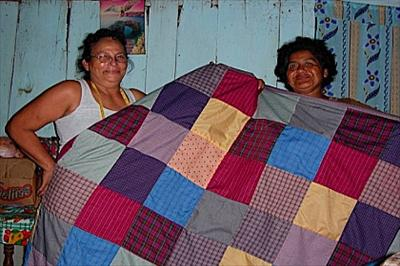 Ladies making blankets for Hotel Con Corazon
