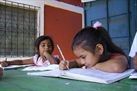 Children studying at Hotel Con Corazon